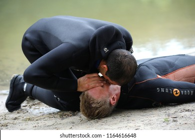 Lesson of artificial respiration. Lifeguard giving drowning mouth-to-mouth resuscitation. Demonstration for mass-media organized by Police Directorate of Kiev. August 10, 2018. Kiev, Ukraine