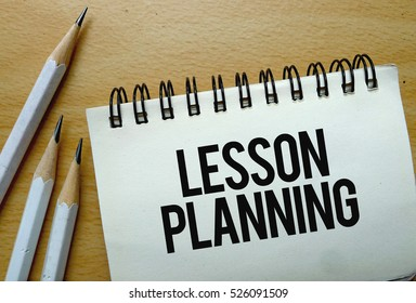 Lesson Planning text written on a notebook with pencils