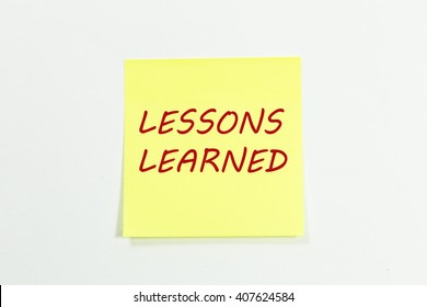 lessons learned word written on yellow sticky notes.