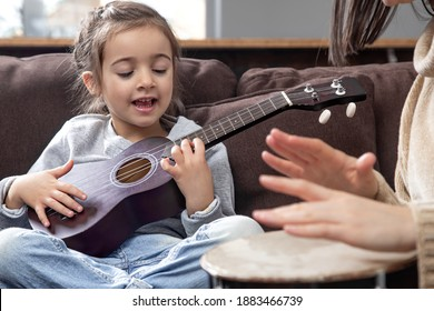 Lessons on a musical instrument. Children's development and family values. The concept of children's friendship and family.