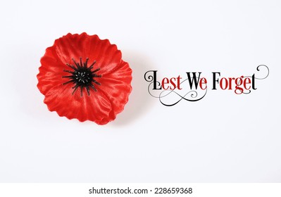 Lest We Forget, Red Flanders Poppy Lapel Pin Badge for November 11, Remembrance Day appeal. on white background with Lest We Forget sample text.