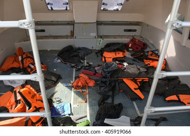 LESVOS, GREECE APRIL 15, 2016: Life Jackets lay discarded in a refugee boat in Mytilene harbour. Mytilene, Lesvos has been a hot spot for migrants and refugees arriving in boats from Turkey.