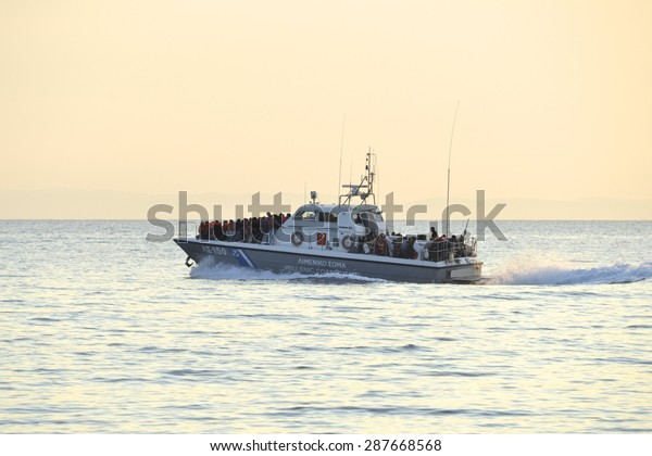 LESVOS, GREECE- JUNE 11, 2015. A Greek Coastguard ship having picked up refugees who have crossed from Turkey to Europe near Mytilene, Lesvos on June 11, 2015. Lesvos is now a hot spot for migrants.