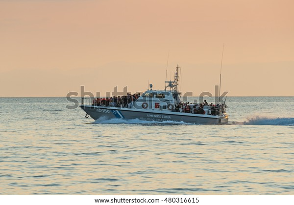 LESVOS, GREECE- JUNE 11, 2015. A Greek Coastguard ship having picked up refugees who have crossed from Turkey to Europe near Mytilene, Lesvos has been a hot spot for migrants crossing from Turkey.