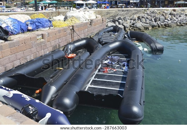 LESVOS, GREECE - JUNE 16, 2015 Inflatable boats used by immigrants to cross the sea from Turkey in Molyvos harbour, Lesvos Greece on June 16, 2015. Lesbos has become a hot spot for migrants to Europe.