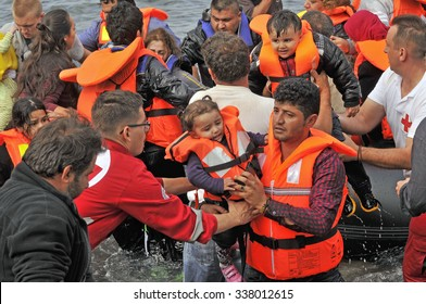LESVOS, GREECE october 12, 2015: Refugees arriving in Greece in dinghy boat from Turkey. These Syrian, Afghanistan and African refugees land their boat at the North coast of Lesvos near Molyvos.