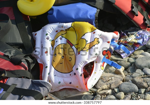 LESVOS, GREECE OCTOBER 24, 2015: Lifejackets, rubber rings an pieces of the rubber dinghies discarded on a beach near Molyvos. Eftalou and Skala Sikaminia. Lesvos has been a hot spot for refugees.