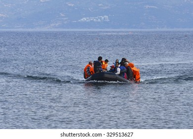 LESVOS, GREECE SEPTEMBER 24, 2015: Refugees arriving in Greece by boat from Turkey. These Syrian refugees land their boat near Molyvos, Lesvos. Turkey can be seen in the background.
