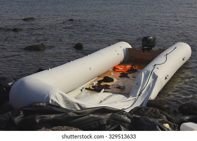 LESVOS, GREECE SEPTEMBER 24, 2015: Inflatable boat used by immigrants to cross the sea from Turkey on a beach near Molyvos. Lesbos has become a hot spot for migrants to Europe.