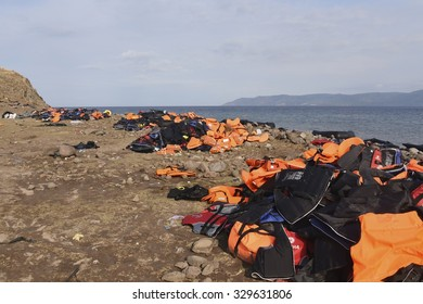 LESVOS, GREECE SEPTEMBER 24, 2015: Life Jackets and rubber rings discarded on a beach near Molyvos. Lesvos has been a hot spot for migrants and refugees arriving in inflatable boats from Turkey.