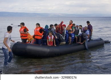 LESVOS, GREECE SEPTEMBER 24, 2015: Refugees arriving in Greece by boat from Turkey in overcast weather. These Syrian refugees land near Molyvos, Mytilene, Lesvos. Turkey can be seen in the background.