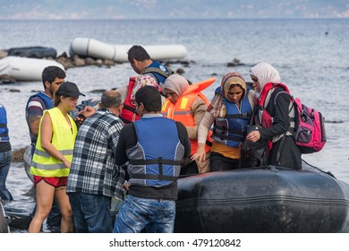 LESVOS, GREECE SEPTEMBER 24, 2015: Refugees arriving in Greece by boat from Turkey. These Syrian refugees land their boat near Molyvos, Lesvos.