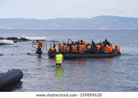 LESVOS, GREECE SEPTEMBER 24, 2015: Refugees arriving in Greece by boat from Turkey. Escaping war and IS (ISIS) these Syrian refugees land their boat on Lesvos. Turkey can be seen in the background.