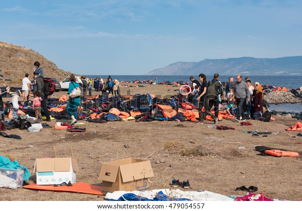 LESVOS, GREECE SEPTEMBER 24, 2015: Newly arrived refugees, discarded life jackets and rubber rings on a beach, Lesvos. It has been a hot spot for migrants and refugees arriving in inflatable boats.