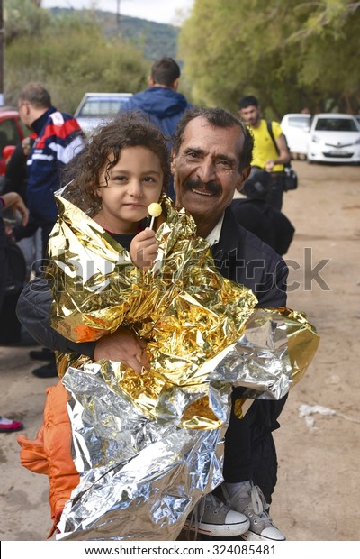 LESVOS, GREECE - SEPTEMBER 29, 2015: Volunteers provide survival blankets for refugee migrants who arrive on inflatable rafts from Turkey. Lesvos, Greece, had been a hot spot for refugees during 2015.
