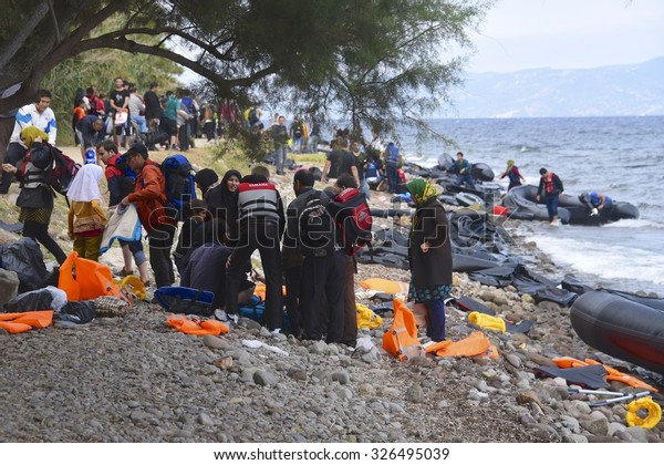 LESVOS, GREECE - SEPTEMBER 29, 2015: A beach on Lesvos, Greece where many boats of refugees have arrived. Turkey, a short distance away, is seen in the background.