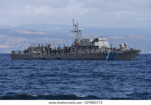 LESVOS, GREECE - SEPTEMBER 29, 2015: A Greek coastguard ship patrols the Aegean Sea between Lesvos and Turkey. Turkey, less than 10km away at the closest point, is seen in the background.