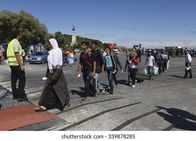 LESVOS, GREECE - SEPTEMBER 30, 2015. Refugee migrants, having arrived on Lesvos in inflatable boats, now board a ferry to mainland Greece continuing their journeys through Europe to seek asylum.
