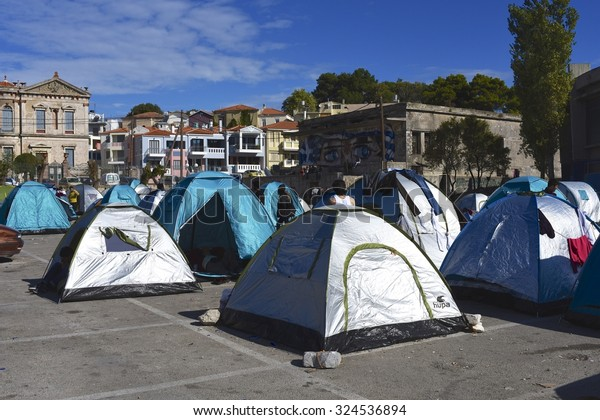 LESVOS, GREECE - SEPTEMBER 30, 2015. A makeshift refugee camp of tents near the harbour in Mytilene, Lesvos. As with Kos, Turkey is very close and the refugees arrive in inflatable boats.