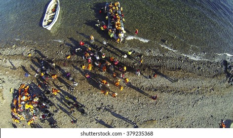Lesvos island, Greece - 13 November 2015. Drone / aerial images from above with Syrian migrants / refugees arrive from Turkey on boat through sea near Molyvos, on an overload dinghy.