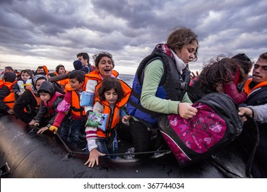 Lesvos island, Greece - 29 October 2015. Syrian migrants / refugees arrive from Turkey on boat through sea with cold water near Molyvos, Lesbos on an overload dinghy. Leaving Syria that has war.