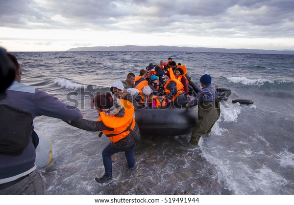 Lesvos island, Greece - 29 October 2015. Syrian migrants / refugees arrive from Turkey on boat through sea with cold water near Molyvos, Lesbos on an overload dinghy. Leaving Syria that has war