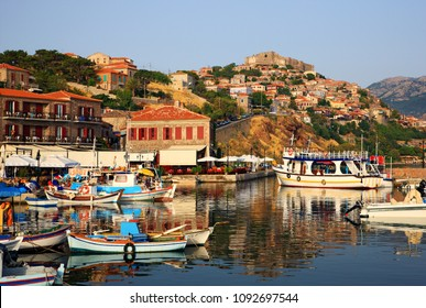 "LESVOS ISLAND, NORTH AEGEAN, GREECE- July 15, 2008. View of the picturesque harbor of Molyvos (or ""Mythimna"") town and its castle."