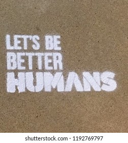 Let Be Better Humans:  inspirational saying on concrete sidewalk