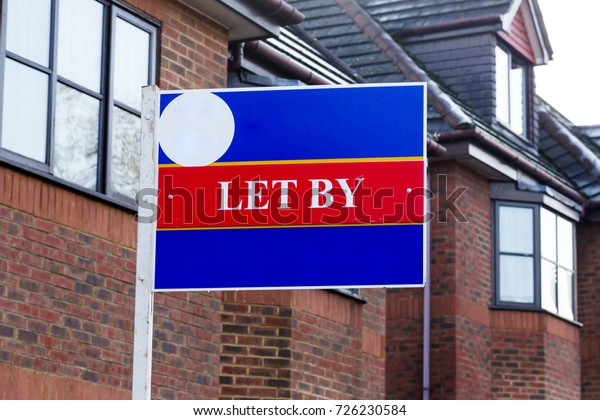 Let by estate agency sign at homes for rent. Horizontal close up shot