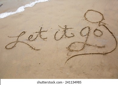 Let it go, a message written in the sand at the beach.
