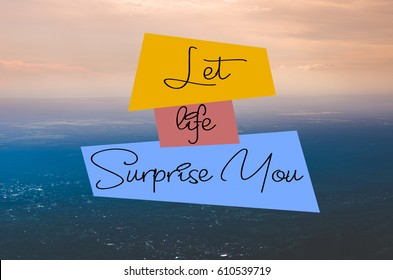 """Let life surprise you"" text on landscape of aerial view background. Vintage tones. Inspiring message."