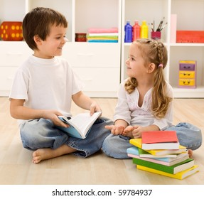 Let me tell you about school - siblings with books talking at home, back to school concept