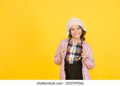 Let the music take you away. Little child listen to music. Happy small girl enjoy music on yellow background. Music school and education, copy space.