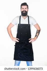 Let my happy smile warm your hearts. Happy man wearing barber or cooking apron. Bearded man happy smiling in bib apron. Brutal hipster with happy smile on unshaven face.