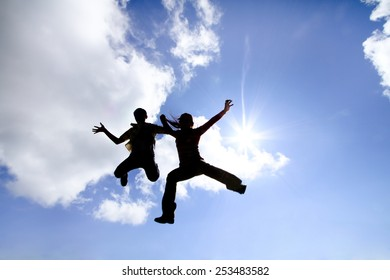 Let success together, silhouette of children and woman jumping to sky with sun