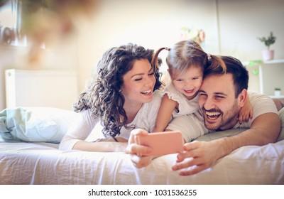 Machen Sie ein Foto von unserer glücklichen Familie.