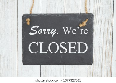 Let your customer know you are closed with this retro closed sign, Sorry we're Closed text on a hanging chalkboard on weathered whitewash textured wood