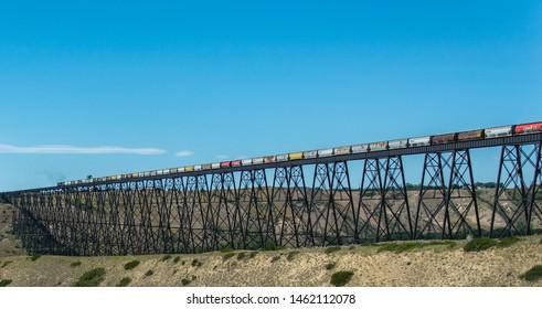 Lethbridge, Alberta / Canada - July 26 2019 - CN Rail train crossing the Lethbridge train bridge, largest in Canada