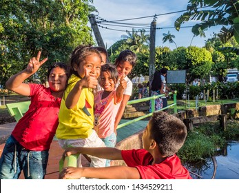 Leticia, Colombia - November 24, 2018: Colombian children smiling and having fun in the Santander Park in Leticia. South America