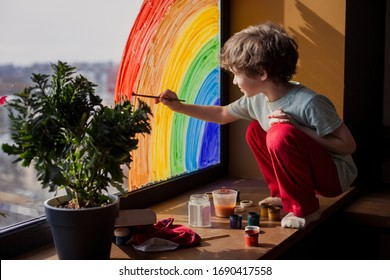 let's all be well. child at home draws a rainbow on the window. Flash mob society community on self-isolation quarantine pandemic coronavirus. Children create artist paints creativity vacation - Shutterstock ID 1690417558