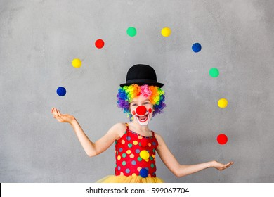 Let's celebrate! Funny kid clown. Child playing at home. 1 April Fool's day concept