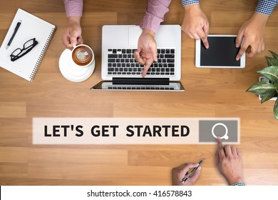 LET'S GET STARTED man touch bar search and Two Businessman working at office desk and using a digital touch screen tablet and use computer, top view