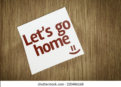 Let's Go Home on Paper Note with texture background