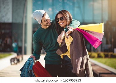 Let's go home to see what we bought. Young couple in shopping.