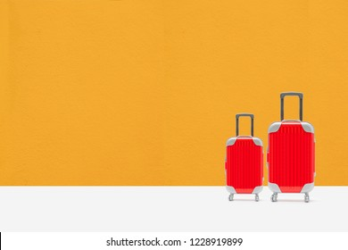 Let's go travel concept. red suitcase with copy space.