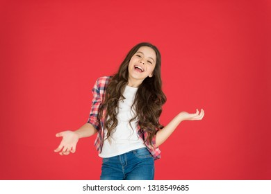 Lets have fun. Come on. Carefree and joyful. Kid girl carefree expression. I do not know. Take it easy. Child with long curly hair feeling cheerful and carefree. Happy childhood. Fun and relax.
