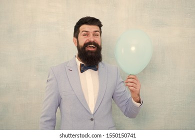 Lets have fun. Man groom blue tuxedo bow tie hold air balloon. Wedding fun. Groom bearded hipster having fun with air balloon. My happy day. Happy guy in cheerful mood. Fun and happiness concept.