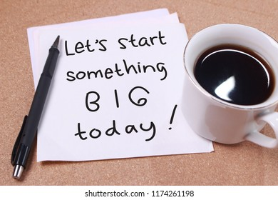 Lets start something big words letter, written on piece of memo paper, work desk top view. Motivational business typography quotes concept