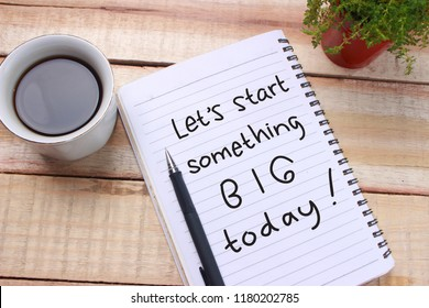 Lets start something big words letter, written on notepad, work desk top view. Motivational business typography quotes concept