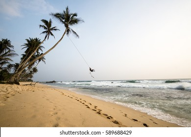 Let's Swing! Rope swing at a beach near Unawatuna in the south of Sri Lanka